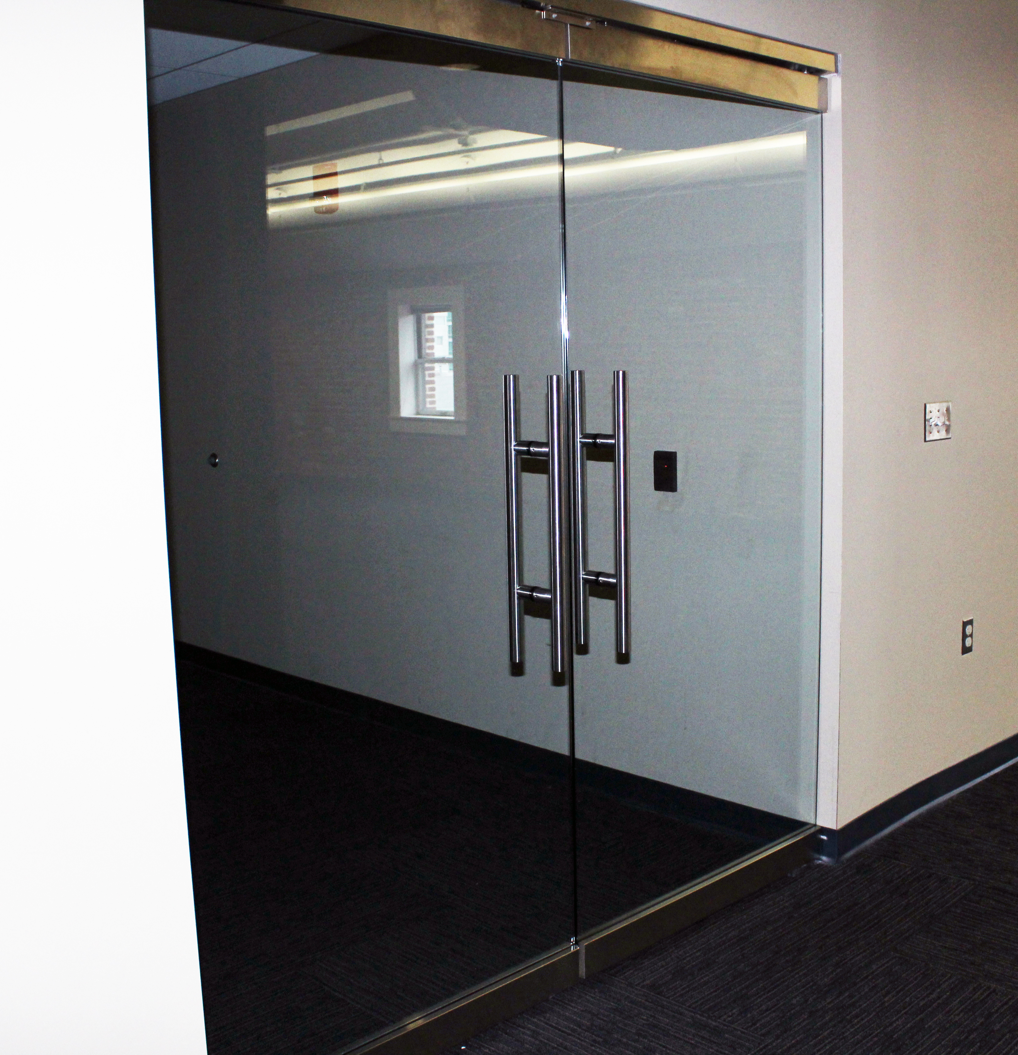 Glass doors into 8th Floor North Warehouse Offices